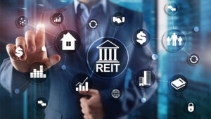 Image of person selecting real estate investment trust (REIT) financial options